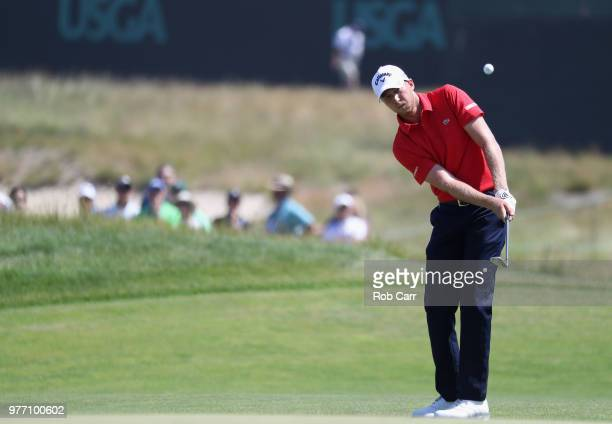 Daniel Berger of the United States chips to the third green during the final round of the 2018 US Open at Shinnecock Hills Golf Club on June 17 2018...