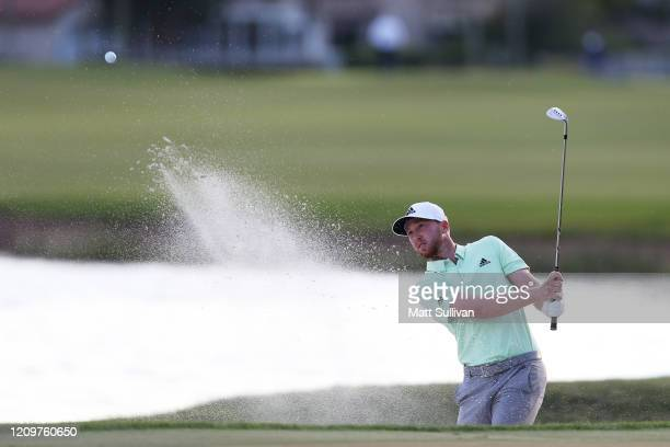 Daniel Berger of the United States hits from a bunker on the 18th hole during the Honda Classic at PGA National Resort and Spa Champion course on...