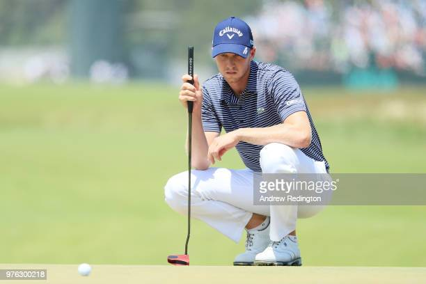 Daniel Berger of the United States lines up a putt on the 16th hole during the third round of the 2018 US Open at Shinnecock Hills Golf Club on June...