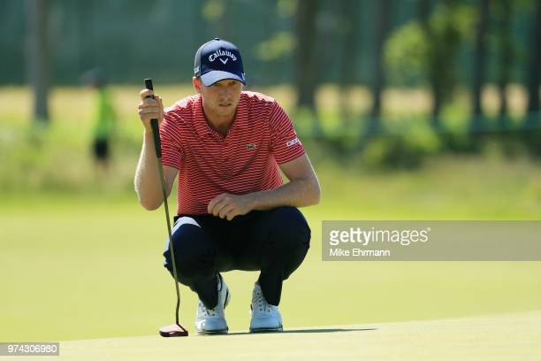 Daniel Berger of the United States lines up a putt on the sixth green during the first round of the 2018 US Open at Shinnecock Hills Golf Club on...