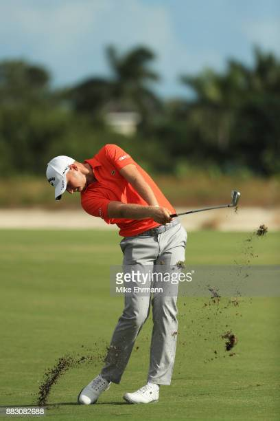 Daniel Berger of the United States plays a shot on the 13th hole during the first round of the Hero World Challenge at Albany Bahamas on November 30...