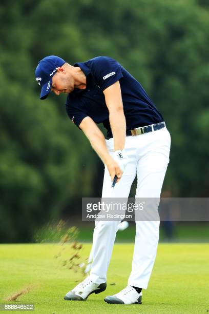 Daniel Berger of the United States plays a shot on the ninth hole during the first round of the WGC HSBC Champions at Sheshan International Golf Club...