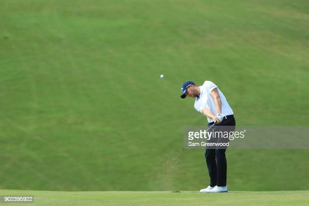 Daniel Berger of the United States plays a shot on the ninth hole during the final round of the Sentry Tournament of Champions at Plantation Course...