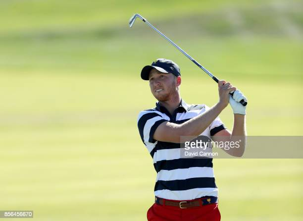 Daniel Berger of the United States plays his second shot on the 14th hole in his match against Si Woo Kim of the International Team during the final...