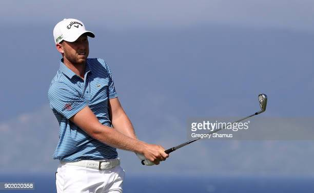 Daniel Berger of the United States plays his shot from the 13th tee during the third round of the Sentry Tournament of Champions at Plantation Course...