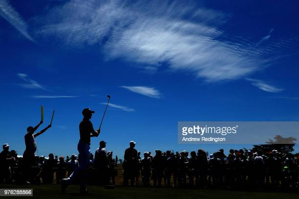 Daniel Berger of the United States plays his shot from the 15th tee during the third round of the 2018 US Open at Shinnecock Hills Golf Club on June...