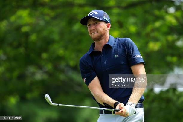 Daniel Berger of the United States plays his shot from the second tee during the first round of the 2018 PGA Championship at Bellerive Country Club...