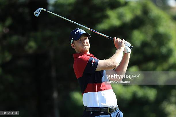 Daniel Berger of the United States plays his shot from the second tee during the final round of the SBS Tournament of Champions at the Plantation...