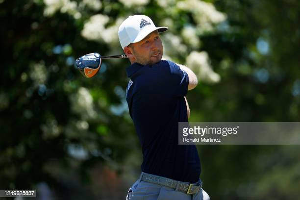 Daniel Berger of the United States plays his shot from the seventh tee during the final round of the Charles Schwab Challenge on June 14 2020 at...