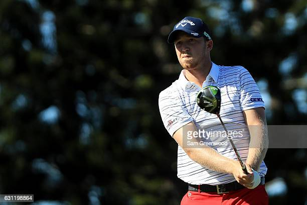 Daniel Berger of the United States plays his shot from the third tee during the third round of the SBS Tournament of Champions at the Plantation...