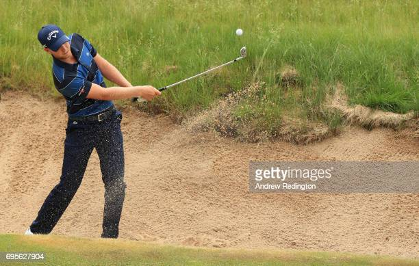 Daniel Berger of the United States plays his shot out of the bunker on the 16th hole during a practice round prior to the 2017 US Open at Erin Hills...