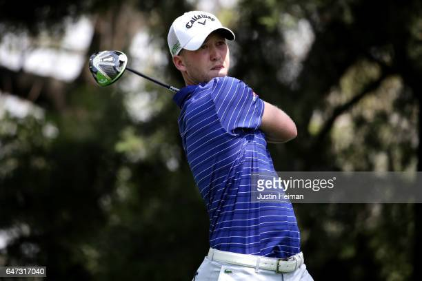 Daniel Berger of the United States plays his tee shot on the sixth hole during the first round of the World Golf Championships Mexico Championship at...