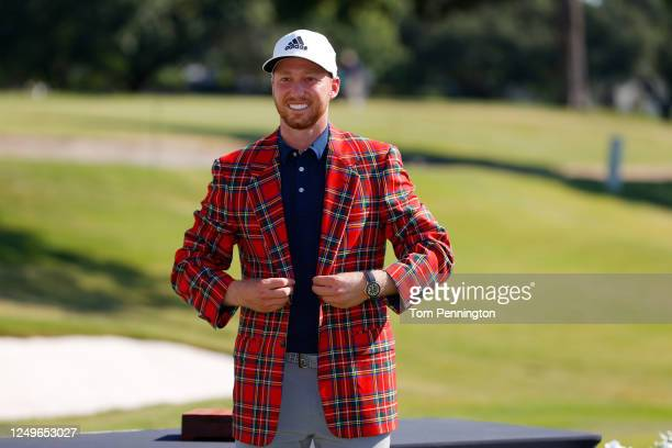 Daniel Berger of the United States puts on the plaid jacket as he celebrates winning after defeating Collin Morikawa of the United States in a...