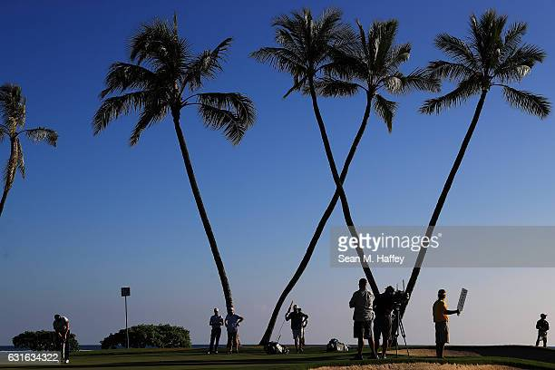 Daniel Berger of the United States putts on the 16th green during the second round of the Sony Open In Hawaii at Waialae Country Club on January 13...