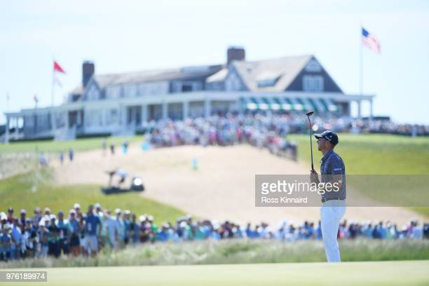 Daniel Berger of the United States reacts to his putt on the first hole during the third round of the 2018 US Open at Shinnecock Hills Golf Club on...