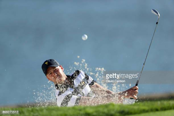 Daniel Berger of the United States team plays his third shot on the 14th hole in his match with Brooks Koepka agianst Louis Oosthuizen and Branden...