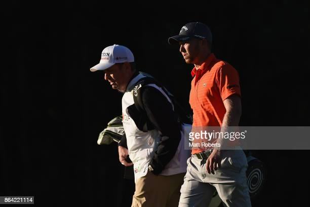 Daniel Berger of the United States walks the fair way with his caddie during the third round of the CJ Cup at Nine Bridges on October 21 2017 in Jeju...