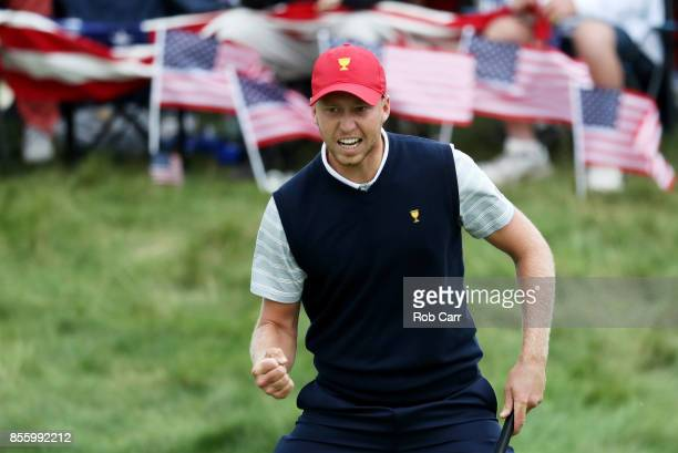 Daniel Berger of the US Team reacts on the 11th green as he and Justin Thomas go one up over Jhonattan Vegas of Venezuela and the International Team...