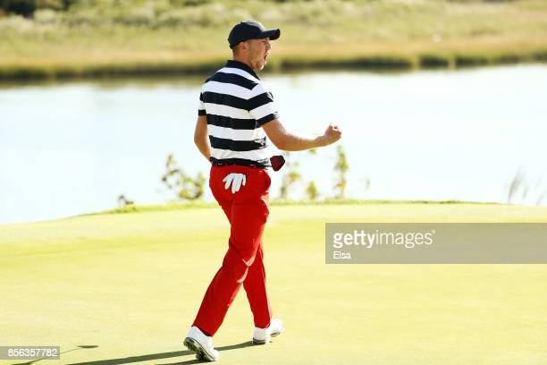 Daniel Berger of the US Team reacts on the 14th green during Sunday singles matches of the Presidents Cup at Liberty National Golf Club on October 1...