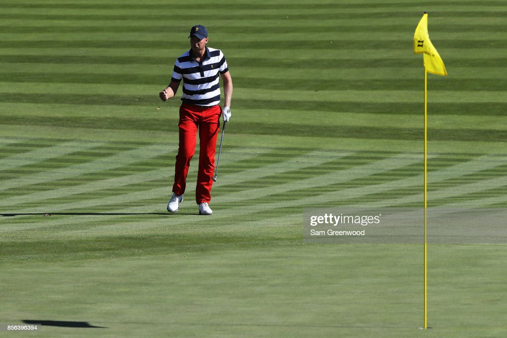 Daniel Berger of the U.S. Team reacts to chipping in on the 11th green during Sunday singles matches of the Presidents Cup at Liberty National Golf Club on October 1, 2017 in Jersey City, New Jersey.