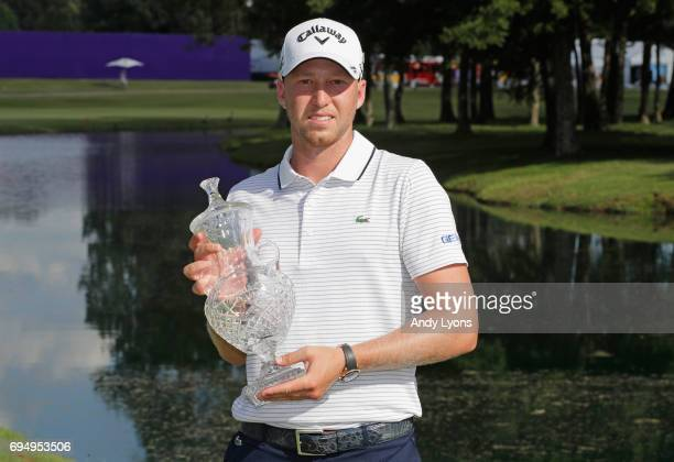 Daniel Berger poses with the trophy after winning during the final round of the FedEX St Jude Classic at the TPC Southwind on June 11 2017 in Memphis...