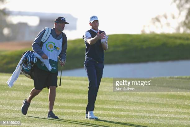 Daniel Berger talks to his caddie on the third hole during the second round of the Waste Management Phoenix Open at TPC Scottsdale on February 2 2018...