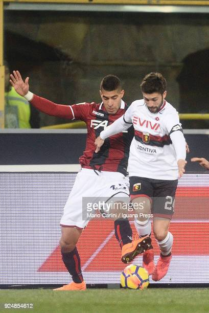 Daniel Bessa of Genoa CFC competes the ball with Adam Masina of Bologna FC during the serie A match between Bologna FC v Genoa CFC at Stadio Renato...