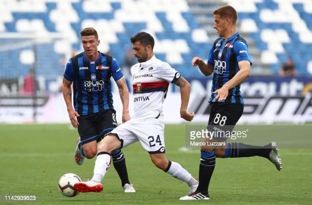 Daniel Bessa of Genoa CFC is challenged by Mario Pasalic of Atalanta BC during the Serie A match between Atalanta BC and Genoa CFC at Mapei Stadium...