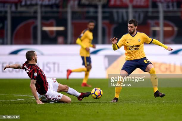 Daniel Bessa of Hellas Verona is tackled by Leonardo Bonucci of AC Milan during the TIM Cup football match between AC Milan and Hellas Verona AC...