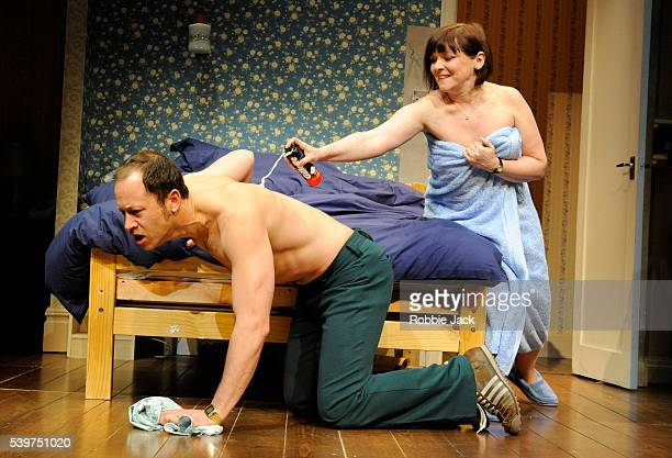 Daniel Betts as Malcolm and Finty Williams as Kate in the production of Alan Ayckbourn's Bedroom Farce directed by Peter Hall at the Duke of York's...