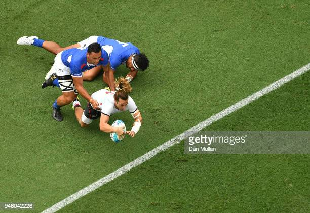 Daniel Bibby of England dives over for a try during Rugby Sevens Men's Pool B match between England and Samoa on day 10 of the Gold Coast 2018...