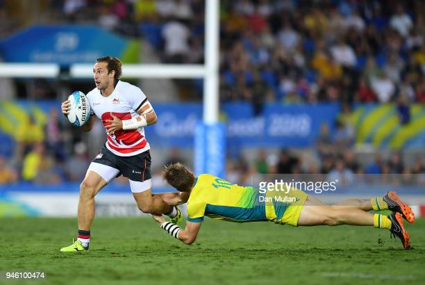 Daniel Bibby of England is tackled by Ben O'Donnell of Australia during the Rugby Sevens Men's Pool B match between England and Australia on day 10...