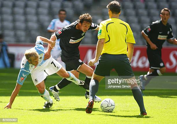 Daniel Bierofka of Muenchen and Markus Feulner of Mainz in action during the Second Bundesliga match between TSV 1860 Muenchen and FSV Mainz 05 at...