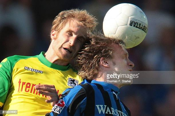 Daniel Bierofka of Munich and Markus Kroesche of Paderborn head for the ball during the Second Bundesliga match between SC Paderborn and 1860 Munich...