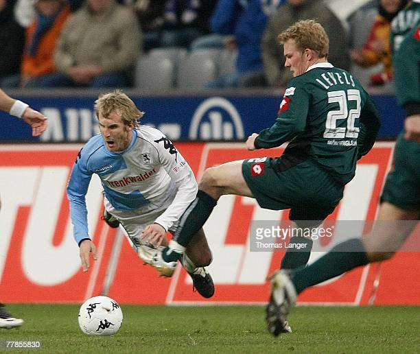 Daniel Bierofka of Munich and Tobias Levels of Moenchengladbach battle for the ball during the 2nd Bundesliga match between TSV 1860 Munich and...