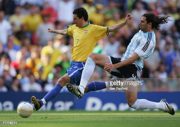 Daniel Bilos of Argentina fails to prevent Elano Blumer of Brazil from scoring during the international friendly match between Brazil and Argentina...