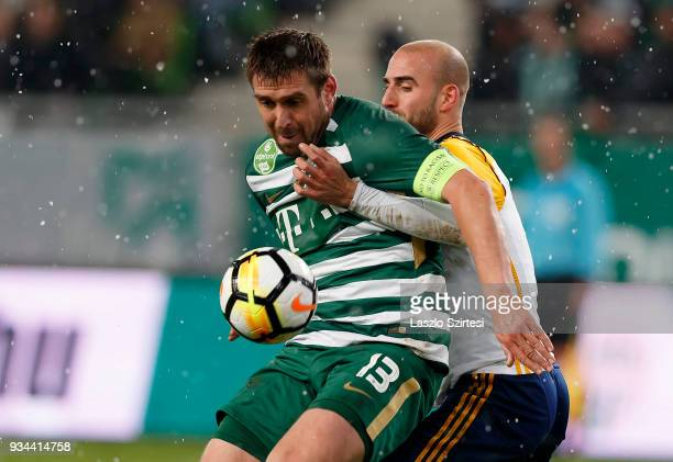 Daniel Bode of Ferencvarosi TC covers the ball from Jonathan Heris of Puskas Akademia FC during the Hungarian OTP Bank Liga match between...
