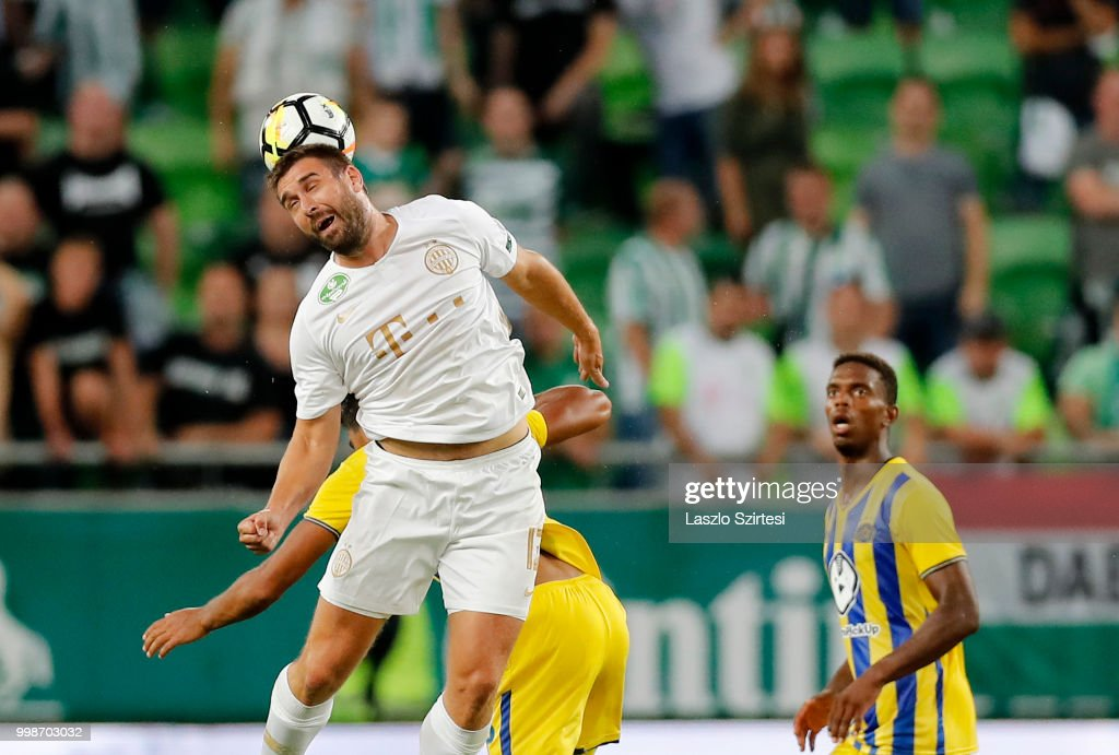 Daniel Bode of Ferencvarosi TC heads the ball next to Amador Silos Jair of Maccabi Tel Aviv FC during the UEFA Europa League First Qualifying Round 1st Leg match between Ferencvarosi TC and Maccabi Tel Aviv FC at Groupama Arena on July 12, 2018 in Budapest, Hungary.