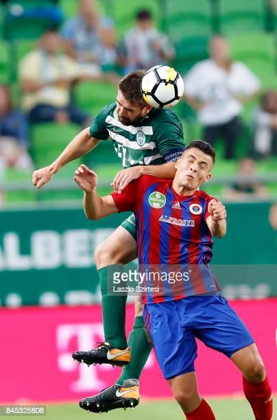 Daniel Bode of Ferencvarosi TC wins the ball in the air from Zsombor Berecz of Vasas FC during the Hungarian OTP Bank Liga match between Ferencvarosi...