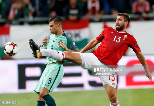 Daniel Bode of Hungary fights for the ball with Pepe of Portugal during the FIFA 2018 World Cup Qualifier match between Hungary and Portugal at...