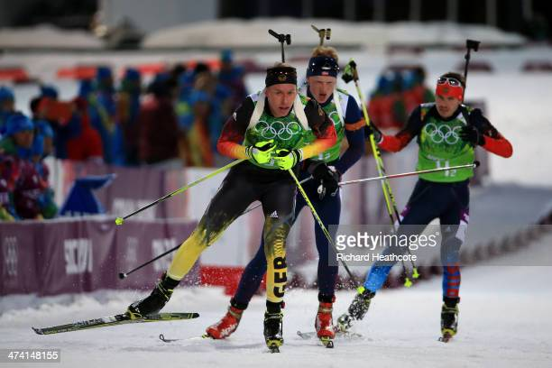 Daniel Boehm of Germany leads Johannes Thingnes Boe of Norway and Evgeny Ustyugov of Russia into the shooting range during the Men's 4 x 75 km Relay...