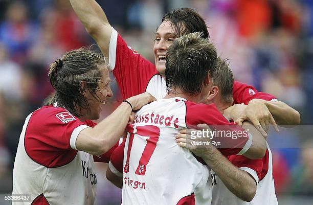 Daniel Bogusz of Siegen is congratulated by his teammates after scoring a goal during the Second Bundesliga match between Sportfreunde Siegen and...