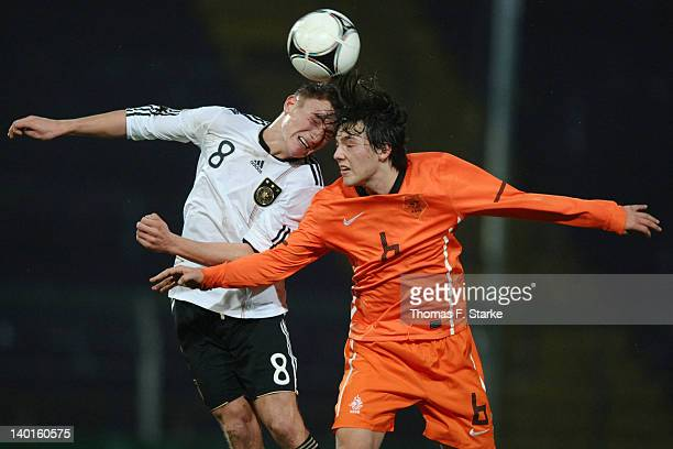 Daniel Bohl of Germany and Joris Van Overeem of Netherlands head for the ball during the U18 international friendly match between Germany and...