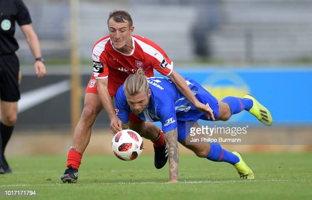Daniel Bohl of Hallescher FC and Alexander Esswein of Hertha BSC compete for the ball during the game between Hertha BSC and Hallescher FC at the...