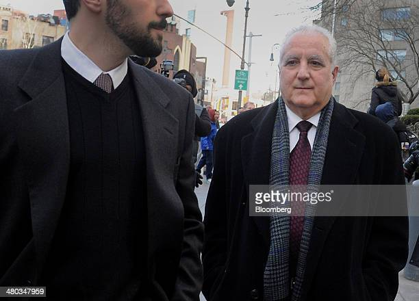 Daniel Bonventre former director of operations at Bernard L Madoff Investments Securities LLC right exits federal court in New York US on Monday...