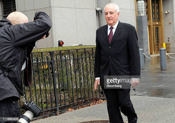 Daniel Bonventre former director of operations for Bernard L Madoff Investment Securities LLC right exits federal court in New York US on Tuesday...