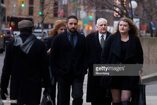Daniel Bonventre former director of operations for Bernard L Madoff Investment Securities LLC second right arrives at federal court for sentencing in...