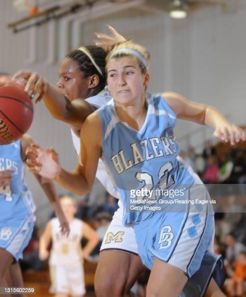 Daniel Boone's Sammi Jo Hughes chases after a loose ball with Gov. Mifflin's Shawn Barczynski .Girls Basketball Daniel Boone Blazers beat Gov....