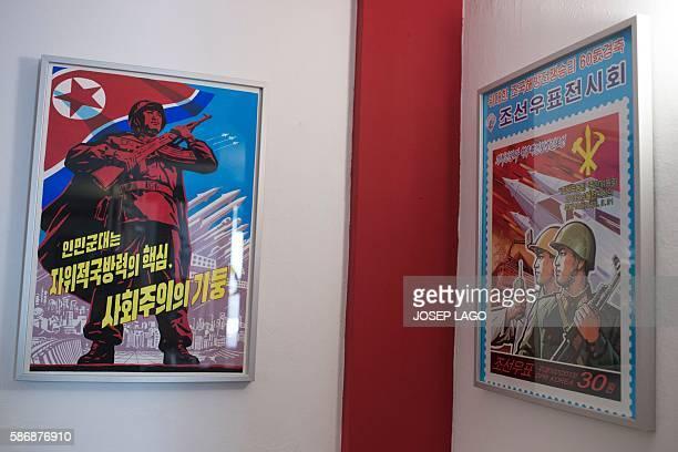 Daniel BOSQUE Original North Korean propoganda posters decorate the wall of the Pyongyangcafe dedicated to friends of the Democratic People's...