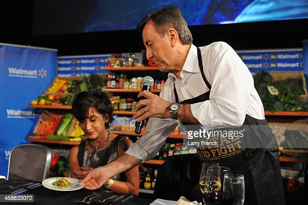 Daniel Boulud brings out potato chips dish for blogger food expert Alli Guleria to degustate during the DC Central Kitchen's Capital Food Fight event...